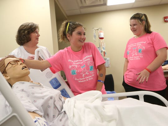 Kylie Robinson, 12, inspects a model patient during a nursing recruitment class with Tallahassee Memorial Hospital for campers from the Oasis Center for Girls and Women on the hospital's campus Thursday, June 8, 2017.