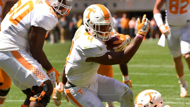 Tennessee's John Kelly scores a touchdown during an NCAA college football spring game in Knoxville, Tenn., Saturday, April 16, 2016.
