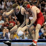 Cornell's Gabe Dean, right, works for control against Lehigh's Nathaniel Brown during their 184-pound championship match at the NCAA Division I wrestling tournament Saturday in St. Louis. Dean beat Brown, 6-2, to become the Big Red's 17th national champion.