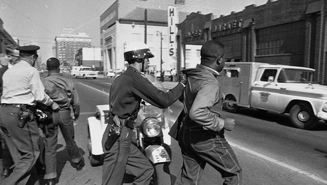 Rev. Martin Luther King Jr., left, and Rev. Ralph Abernathy, right, leaders of the civil rights movement, are hauled off to a paddy wagon by police following a demonstration in Birmingham, Ala. in 1963.