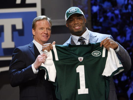 FILE - In this April 26, 2008, file photo, Ohio State's Vernon Gholston, right, poses with NFL commissioner Roger Goodell after being selected sixth overall by the New York Jets during the NFL draft in New York. No team wants to pay millions for a wasted draft pick. (AP Photo/Jason DeCrow, File)