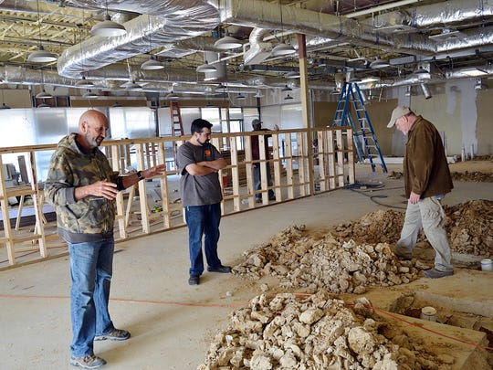 Partners Mike McFarland, left, Nathan Glenn and Jack Curtis discuss upcoming construction details for The Feathered Cow restaurant coming soon to the reservoir area at 1079 Spillway Road in the Kroger shopping center.