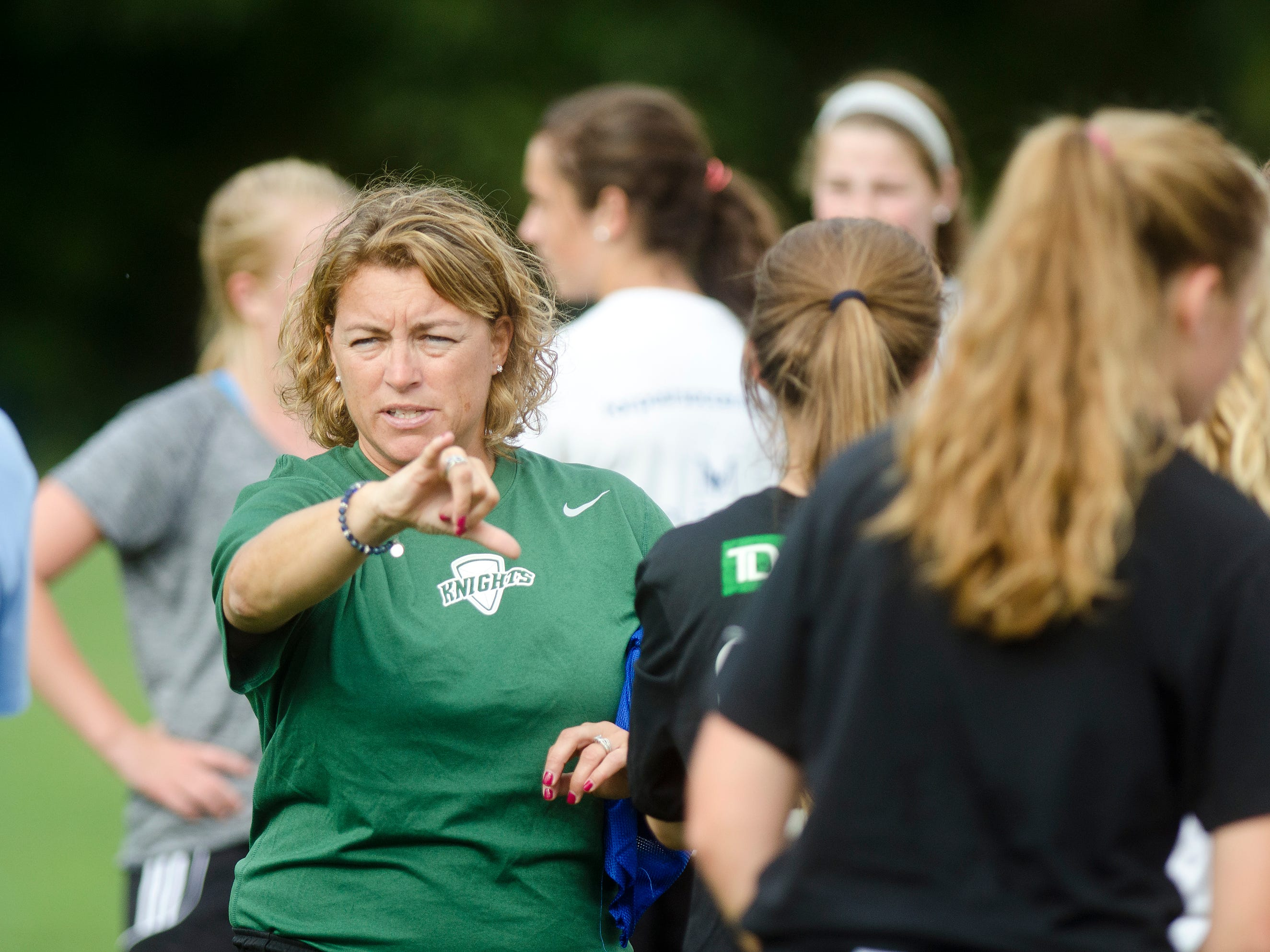 Rice Memorial High School girls soccer coach Shawntel Burke directs practice on the opening day of preseason on Thursday in South Burlington.