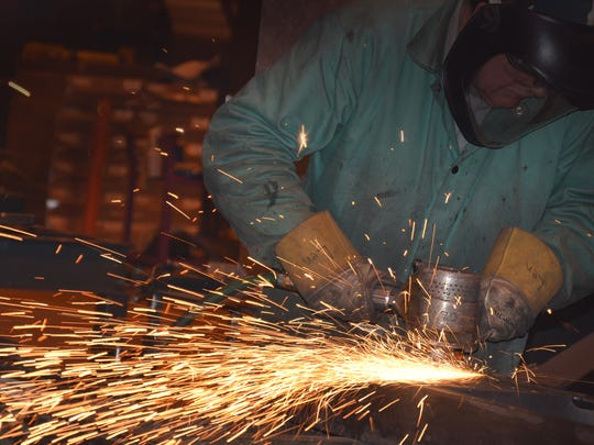 A welder works on a project at MEGTEC, a global design, engineering, manufacturing and services company in De Pere. Welders continue to be in demand for a wide range of manufacturers.