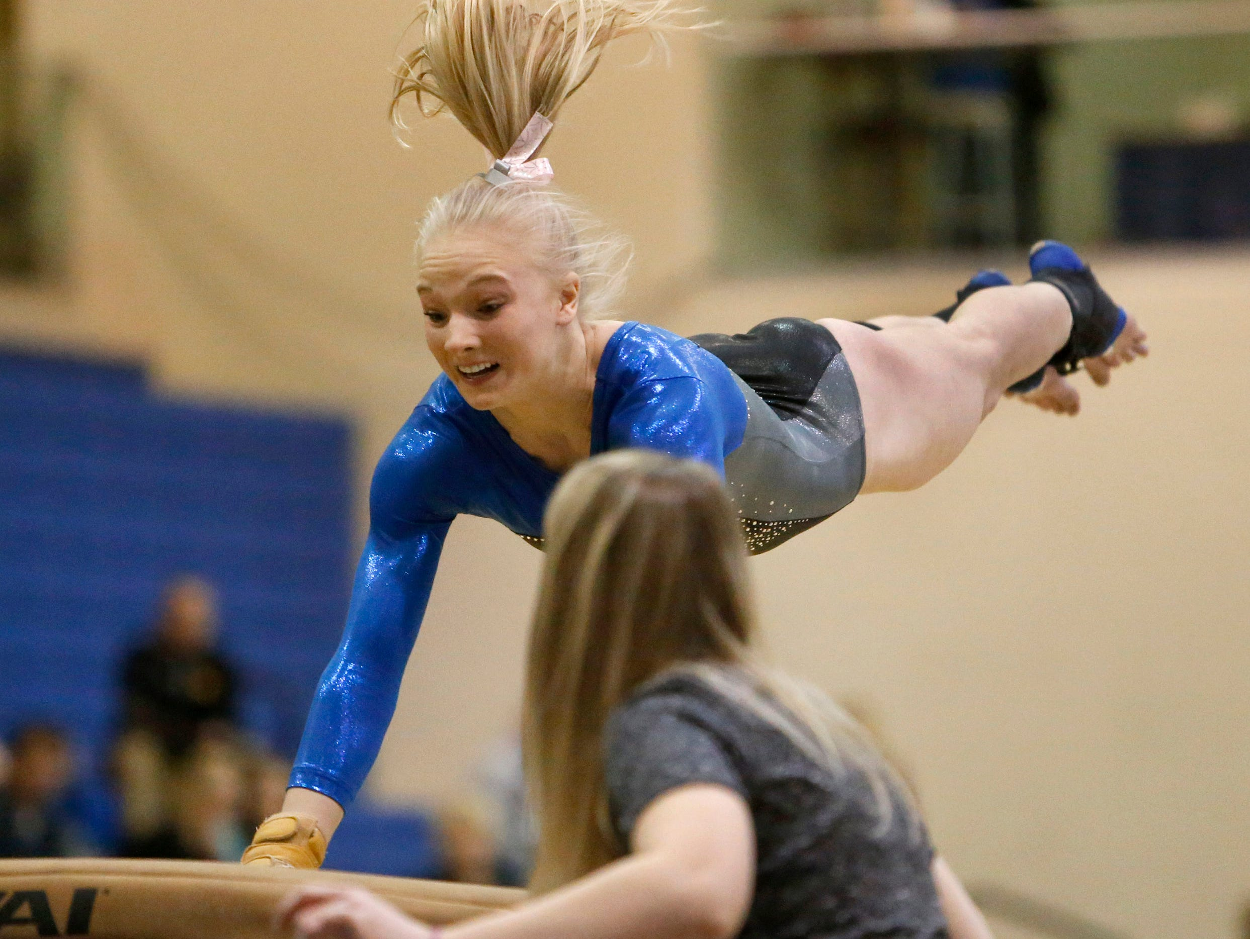 Sioux Falls O'Gorman's Callie DeWitt leaps for the vault during Saturday's individual competition at the Class AA State Gymnastics Meet at the Golden Eagles Arena.