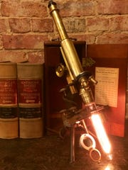 This 1895 Bausch and Lomb compound brass microscope
