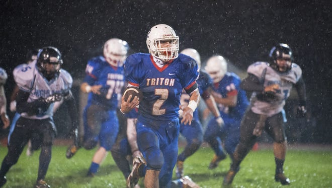 Triton's Dominic Staiano looks for running room during  a game earlier this season against Highland. The Mustangs are scheduled to host Paul VI in a West Jersey Football League Constitution Division game Friday night.