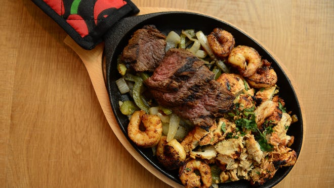 Bayside Cantina's Tres Fajitas-  Charred Chicken, carne asada & marinated shrimp.