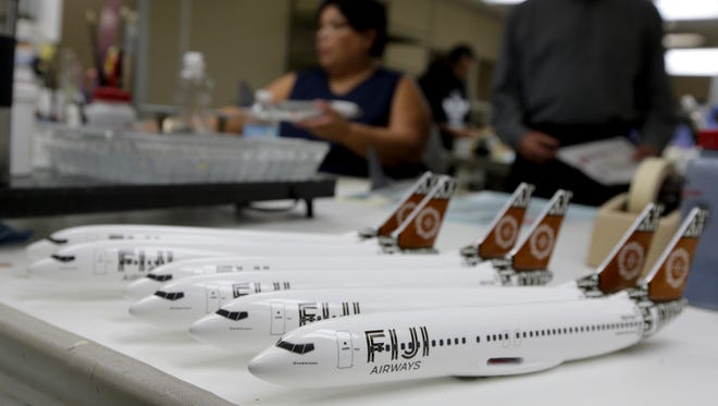 In this Feb. 5, 2015 photo, Fiji Airways model planes are lined up awaiting completion at Pacific Miniatures in Fullerton, Calif.