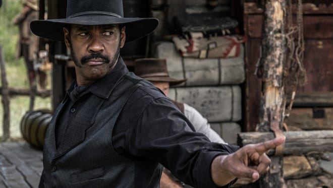 "Denzel Washington stars as bounty hunter Sam Chisolm in the new ""Magnificent Seven."""