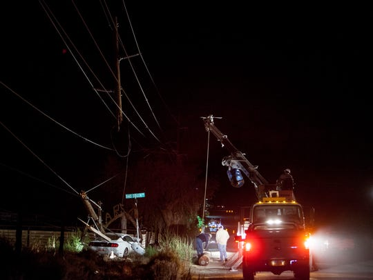 Washington City utility crews repair downed power lines
