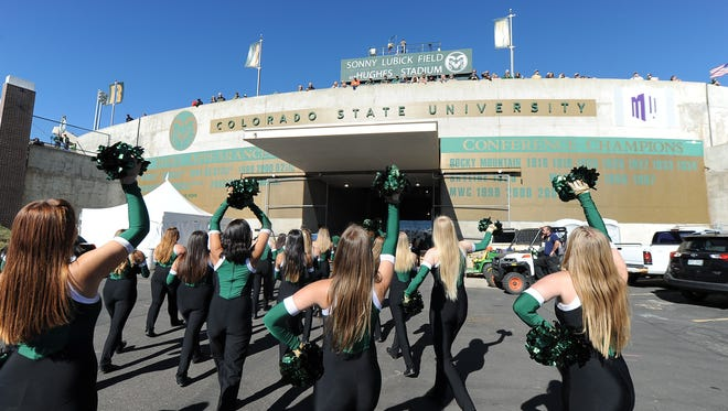 Colorado State Rams cheerleaders walk into Sonny Lubick Field at Hughes Stadium before the game against the San Diego State Aztecs
