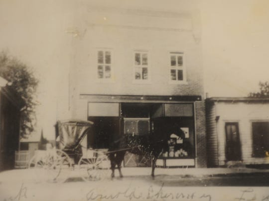 A horse drawn cart stands in front of the original drug store building circa 1913 that would later become Rayfield's Pharmacy in the mid-70s. Rayfield's is celebrating 40 years in business on the Eastern Shore this month.