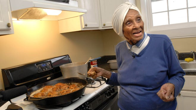 Willie Mae Seaton cooks fried chicken for volunteers helping to rebuild her Hurricane Katrina-devastated restaurant, Willie Mae's Scotch House, in New Orleans on March 4, 2007. Seaton, a chef recognized for her classic American food and whose neighborhood restaurant helped put fried chicken on the culinary map, has died at 99.