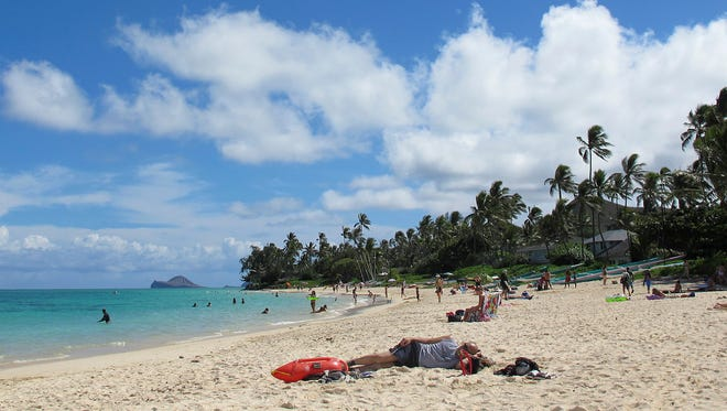 This Oct. 29, 2013 photo shows people at Lanikai Beach in Kailua, Hawaii.