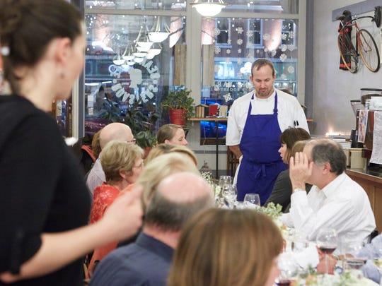 Chef Jason Shaeffer chats with guests between courses during the Fort Collins Secret Supper on Thursday, January 15, 2015 at Bean Cycle Roasters.