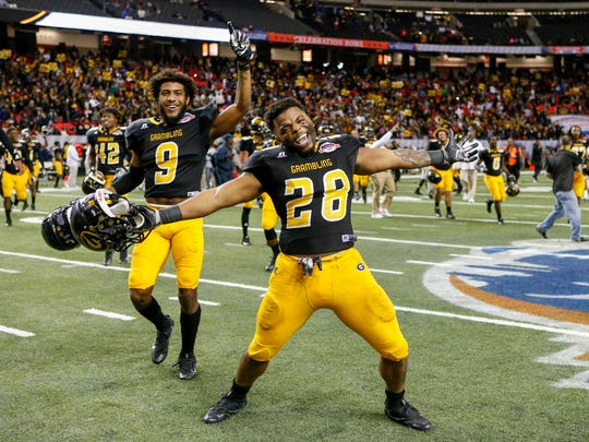 Grambling State Tigers running back Jestin Kelly (28) and wide receiver Devohn Lindsey (9) celebrate after defeating the North Carolina Central Eagles 10-9 in the Celebration Bowl at the Georgia Dome.