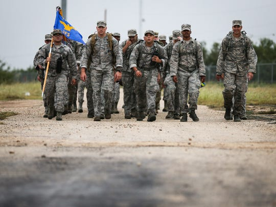 Service members march the last leg of the 11th annual