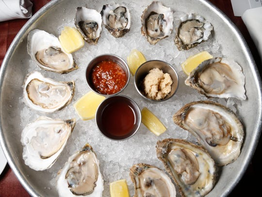 The seasonal raw oysters are served with horseradish,