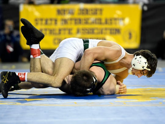 Delbarton's Patrick Glory (white) and South Plainfield's Joe Heilmann wrestle in the 126-pound final bout during the NJSIAA state wrestling championships in Atlantic City, NJ on Sunday, March 4, 2018.