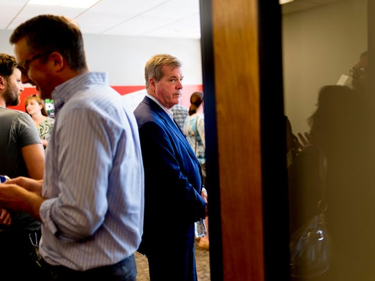 Democratic gubernatorial candidate Karl Dean mingles at the opening of his campaign office at 900 East Hill Ave. in Knoxville on Tuesday, July 3, 2018.