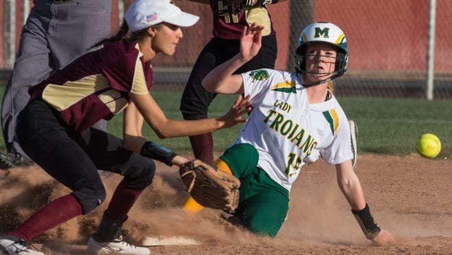 Mayfield's Katie Menges advances to second base as Gadsden's Nicole Gonzalez takes the throw Friday night at the Field of Dreams Softball Complex.