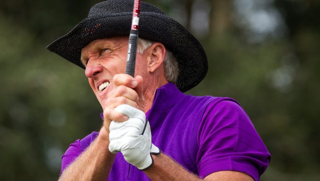 Greg Norman tees off on the 11th hole while playing in the Franklin Templeton Shootout Pro-Am on Tuesday, Dec. 9, 2014, at the Tiburon Golf Club in North Naples.  (David Albers/Staff)