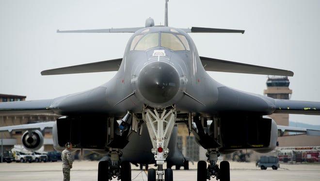 U.S. Air Force Staff Sgt. Cody Owens, 28th Aircraft Maintenance Squadron flight controls journeymen, awaits engine shut-down of a U.S. Air Force B-1B Lancer deployed from Andersen Air Base, Guam, at Osan Air Base, South Korea, on Sept. 21, 2016.