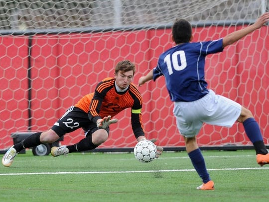 Sturgeon Bay goalie Caleb Owens makes a save Thursday
