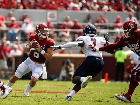 Oklahoma quarterback Baker Mayfield looks for areceiver during action in the Sooners game against the UTEP M iners. The Sooners went on to defeat UTEP 56-7 in their season opener before a sold out crowd.