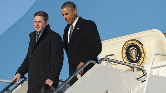 President Barack Obama and senior adviser Dan Pfeiffer (left) disembark from Air Force One last year on Pfeiffer's last day working at the White House.