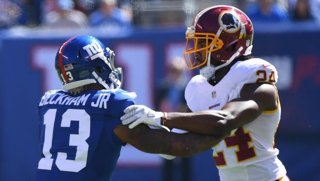 Giants receiver Odell Beckham Jr. and Redskins cornerback Josh Norman exchange words during Sunday's game.