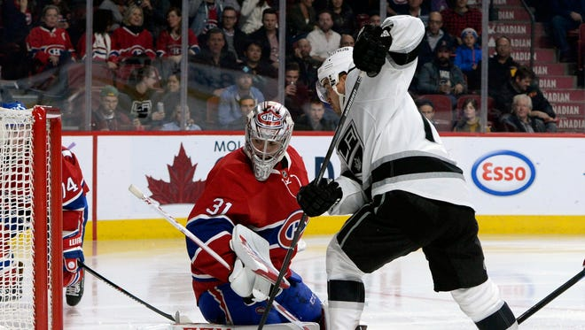 Canadiens goalie Carey Price (31) makes a save against Kings forward Devin Setoguchi (10) during the third period.