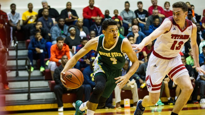 Wayne State's Marcus Moore drives against Detroit Mercy's Cole Long in WSU's 85-79 exhibition win at Detroit on Oct. 29, 2016.