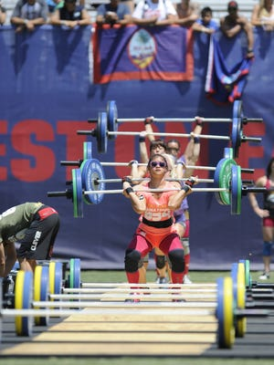 In this file photo, Guam's Nicole Tainatongo participates in the women's clean and jerk during the the CrossFit Games at the StubHub Center on July 27, 2013, in Carson, California.