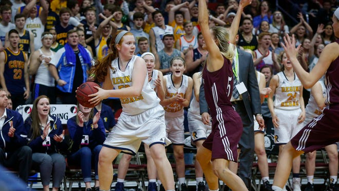Iowa City Regina junior Katie Dunn looks for an open teammate against Western Christian during the Iowa high school girls state basketball tournament on Thursday, March 2, 2017, at Wells Fargo Arena in Des Moines.