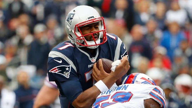 New England Patriots quarterback Jacoby Brissett (7) is hit by Buffalo Bills inside linebacker Zach Brown (53) during the first half at Gillette Stadium.