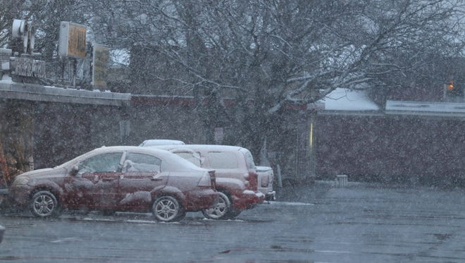 Snow across the area faces morning commuters Friday.