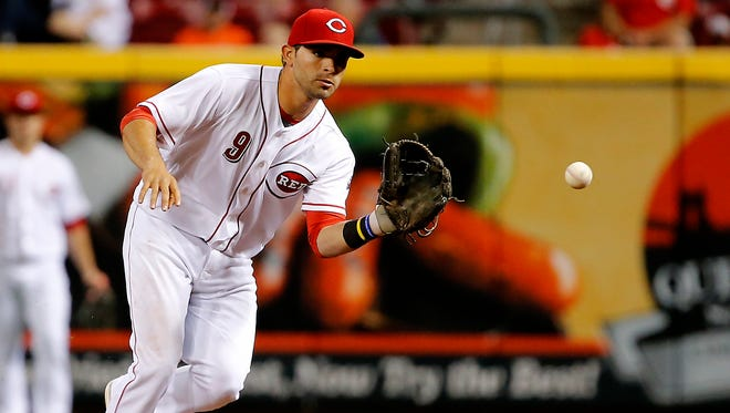 Cincinnati Reds shortstop Jose Peraza (9) fields the ball in the sixth inning during the interleague baseball game between the Baltimore Orioles and the Cincinnati Reds, Thursday, April 20, 2017, at Great American Ball Park in Cincinnati.