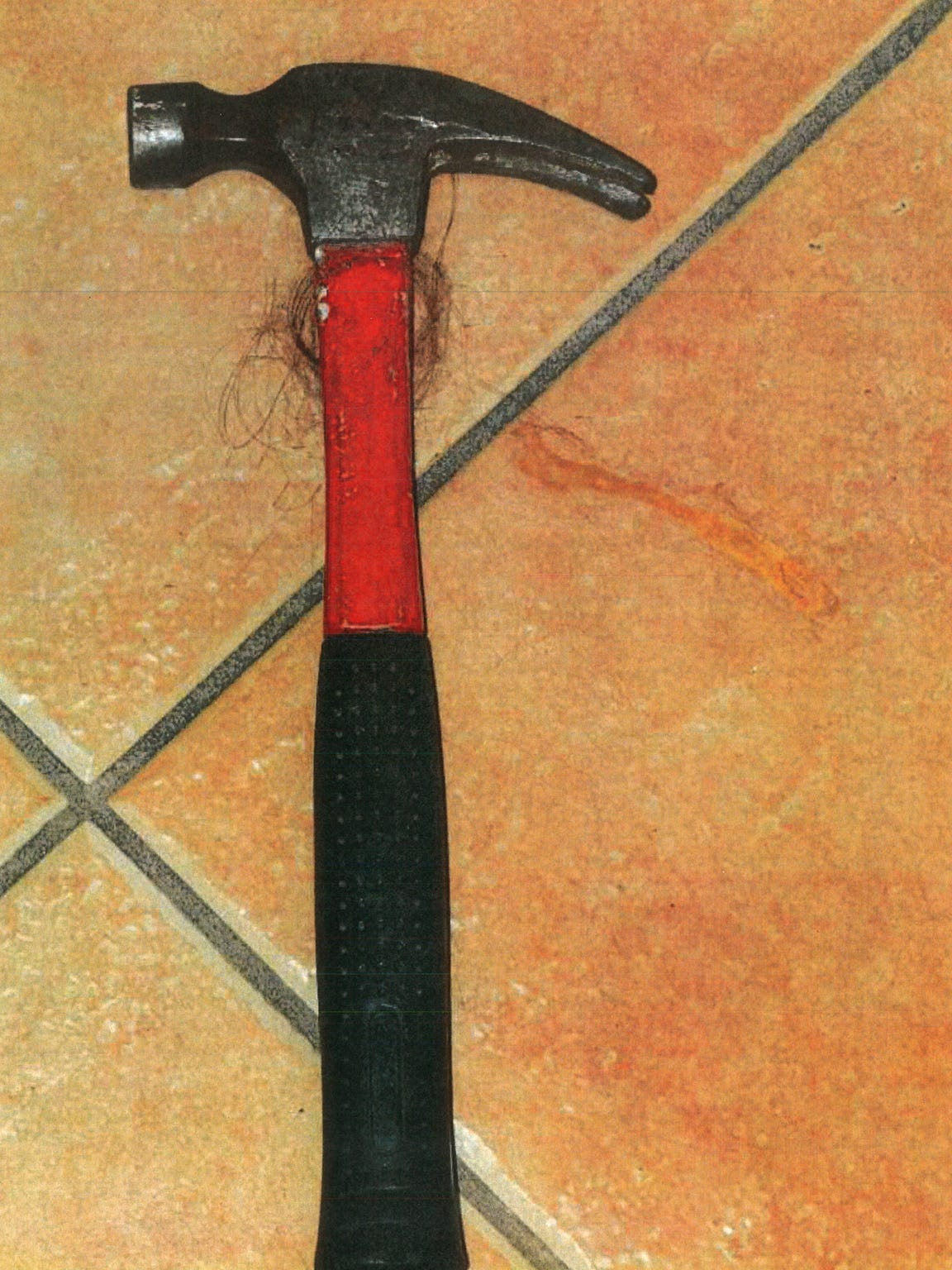A hammer found at the crime scene in the homicide of