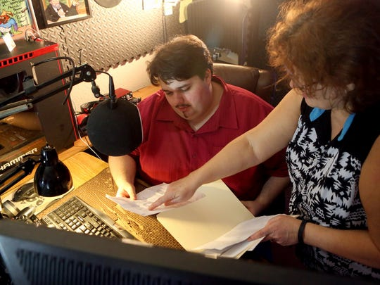"""Kyle Land looks over scripts with his mother Carla before recording a voice-over on Tuesday, Jan. 31, 2017, in Corpus Christi. Land won the """"Explorers Wanted"""" voice-over contest, which got him several voice-over part in the video game """"Mass Effect: Andromeda."""" The voice-overs were recorded in Los Angeles."""