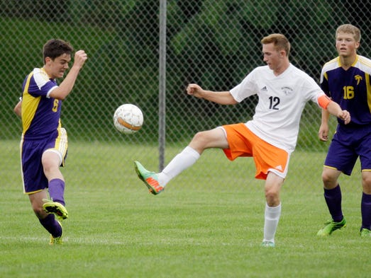 Sheboygan Falls' John Schreurs (6) tries to gain control of the ball from Plymouth's Zach Gambrell (12) during action Thursday August 28, 2014 in Plymouth.