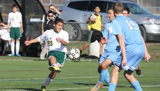 Hastings' Nate Constantine delivers a shot for a goal against Rye Neck at the Section One Class B boys final at Arlington High School, Oct. 31, 2015.
