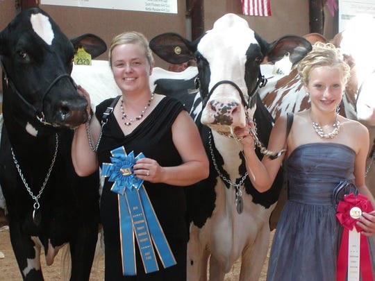 Sara Feldmann (left) and Ava Booth showed the top two cows at the Sheboygan County Holstein Futurity on Sept. 4. Cow-Palace Fever So Real (left) was the top winner while Booth's animal, Lyn-Vale Goldsun Glaze-ET was runner up.