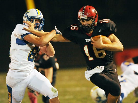 Pewaukee's TJ Watt fights off would-be tackler Nathan Henrichs of New Berlin West for a gain during a game in 2012.