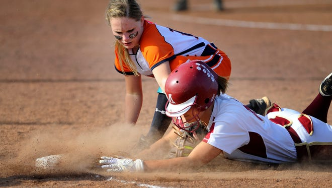 Dickson Co. first baseman Ashley Scott (14) tags out Munford base runner Courtney Bonaiuto (8) at first base in the first round of Class AAA TSSAA softball tournament Tuesday May 20, 2014, in Murfreesboro, Tenn.