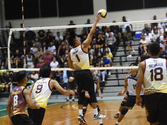 Father Duenas player Nathaniel Gaitan (1) spikes the ball against the Tiyan Titans during their Independent Interscholastic Athletic Association of Guam Boys' Volleyball Championship game at the University of Guam Calvo Field House on May 12, 2018.