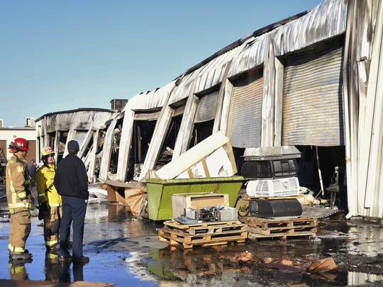 Firefighters continue to monitor a building at Paul Evert's RV Country Wednesday morning. The warehouse caught fire just after 6 p.m. on Tuesday.
