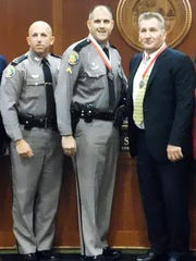 From left, Florida Highway Patrol Lt. Greg Bueno with
