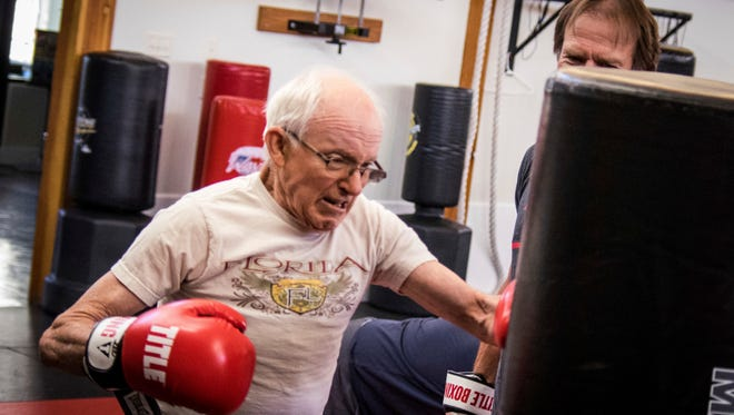 In this June 28, 2017 photo, Jim Erickson, 72, takes part in Rock Steady Boxing, a nationwide program to help people with Parkinson's disease stay active and healthy in Helena, Mont. Rock Steady holds classes three times per week at Frederick's ATA Martial Arts gym in Helena.  (Matt Neuman/Independent Record via AP)
